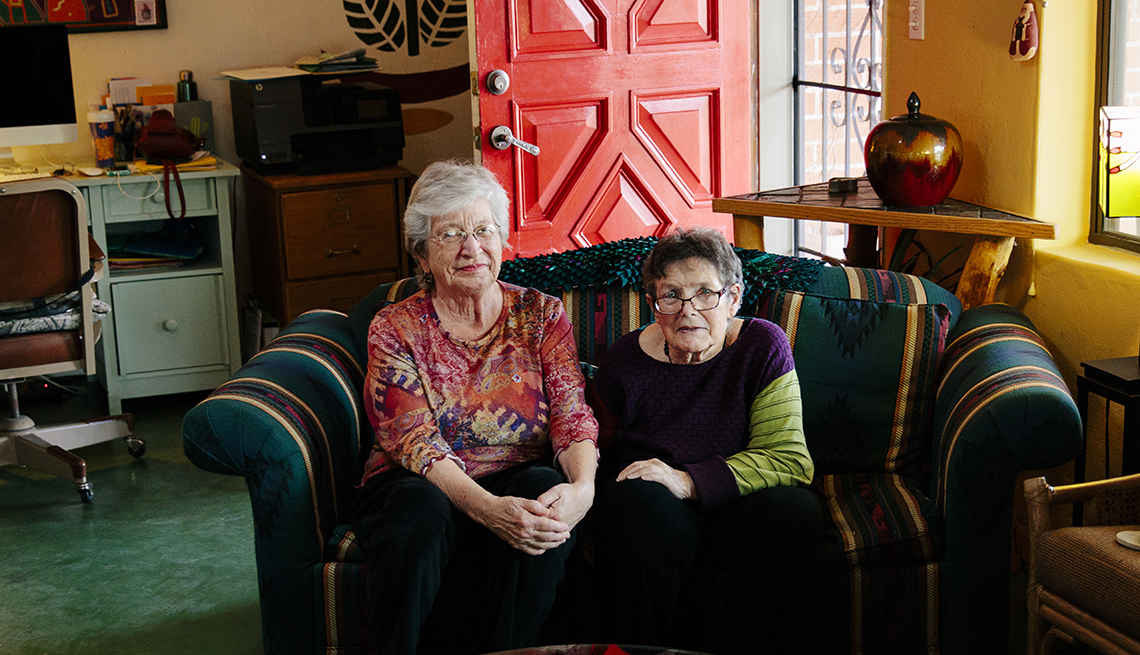 Deborah Knox, left, and Sharon Kha are roommates. The pair had to decide which sentimental coffee table of their own to use in their living room when Deborah moved in with Sharon. It was Sharon's wooden mission door turned table versus Deborah's river dri