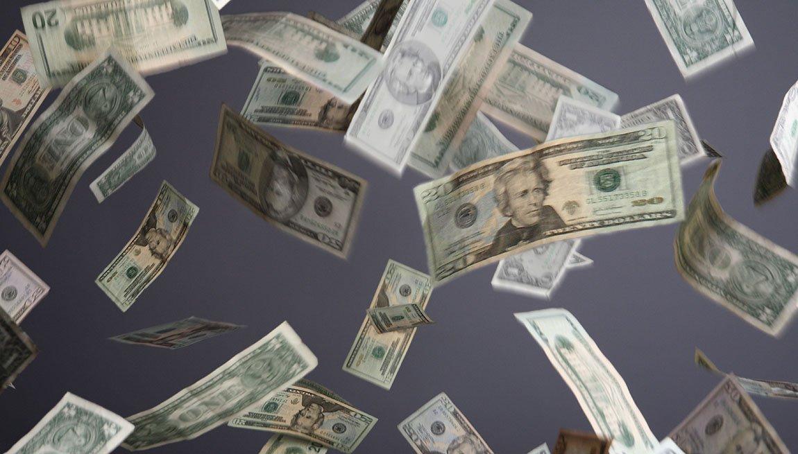 Billetes de dólar suspendidos en el aire