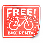 illustration of a red sticker with a bicycle and the words free bike rental on it