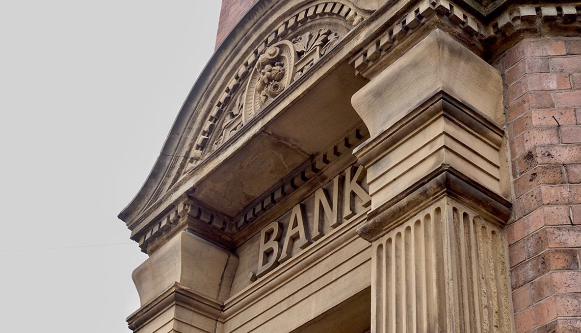 Bank sign carved on classic stone building