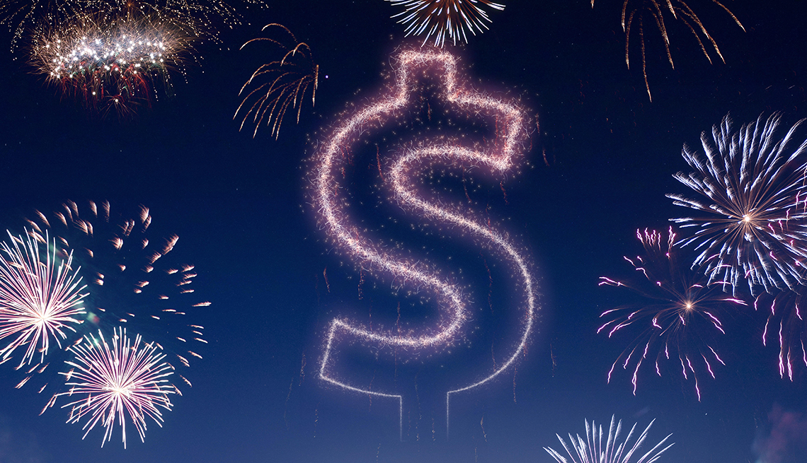 night sky lit up with fireworks in the shape of a dollar sign
