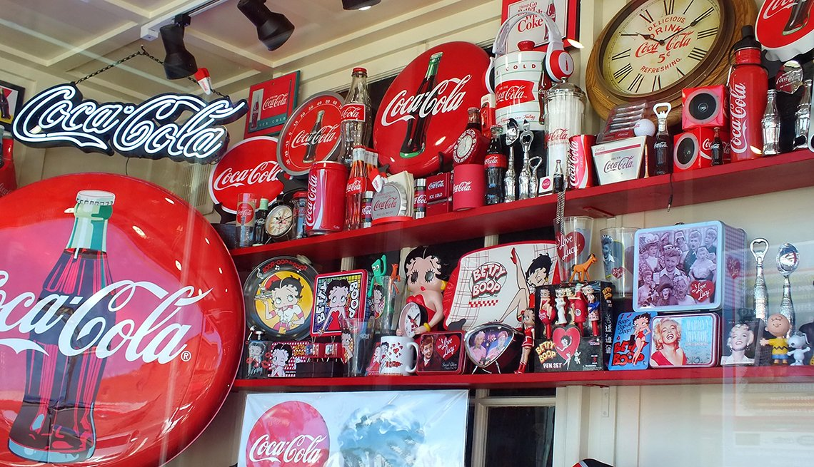 item 4 of Gallery image - store shelves with coca cola memorabilia on display