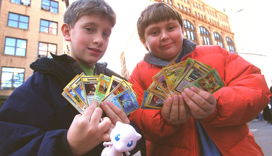 item 7 of Gallery image - two children standing in street display collectible pokemon trading cards