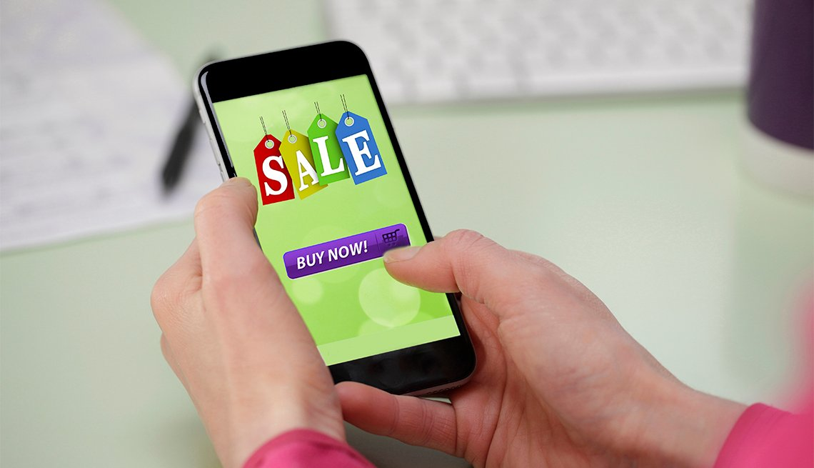 Women holding smartphone buying online sale item