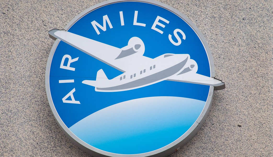 logo for an air miles rewards program displayed on a wall