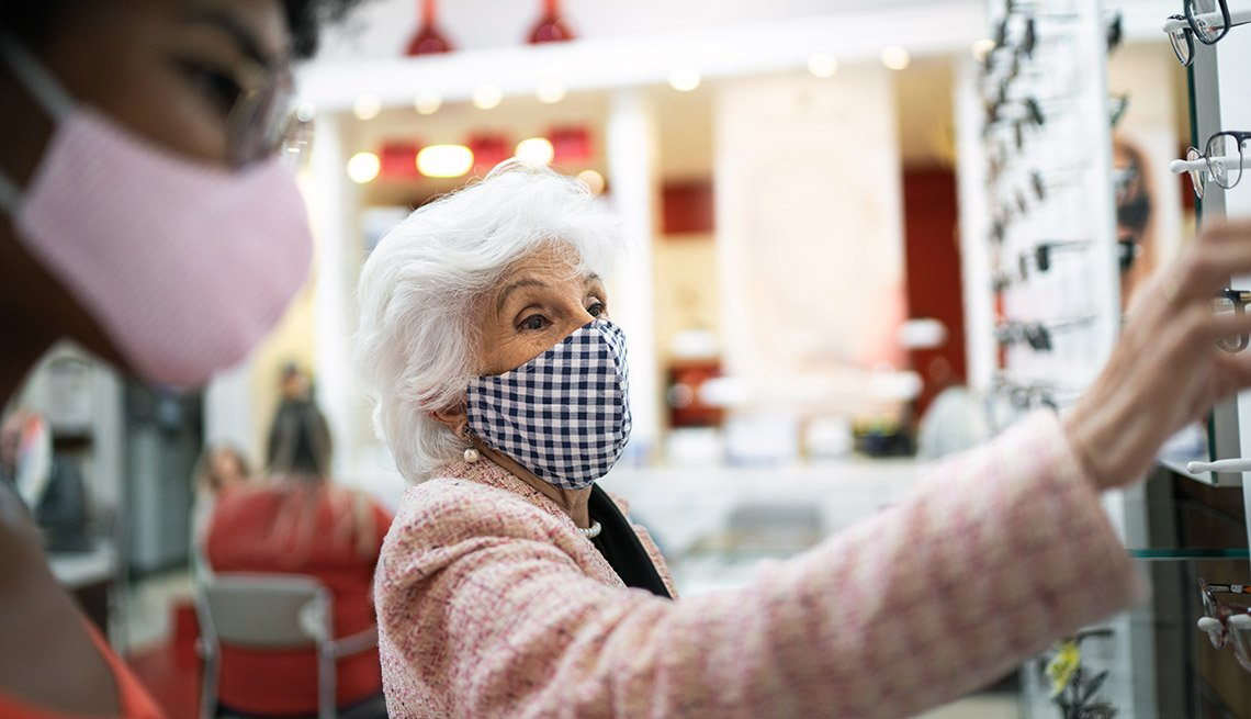 woman shopping for prescription eyeglasses while wearing a mask during the pandemic