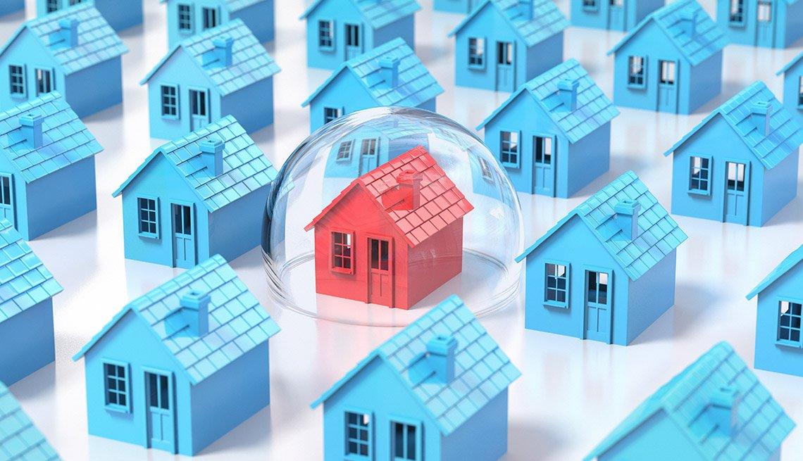Ilustración de casas azules y una roja dentro de una burbuja.
