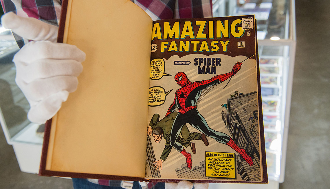 item 5 of Gallery image - White gloved hand holds a valuable bound book of rare Spider-Man comics