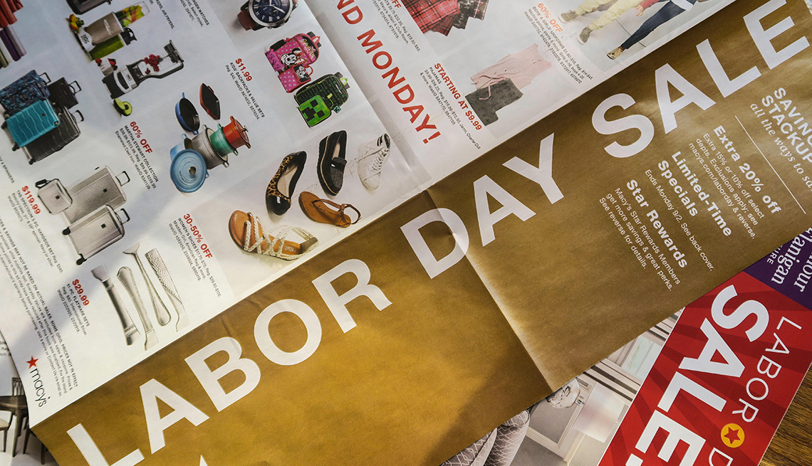 Labor Day sales close up of newspaper ads