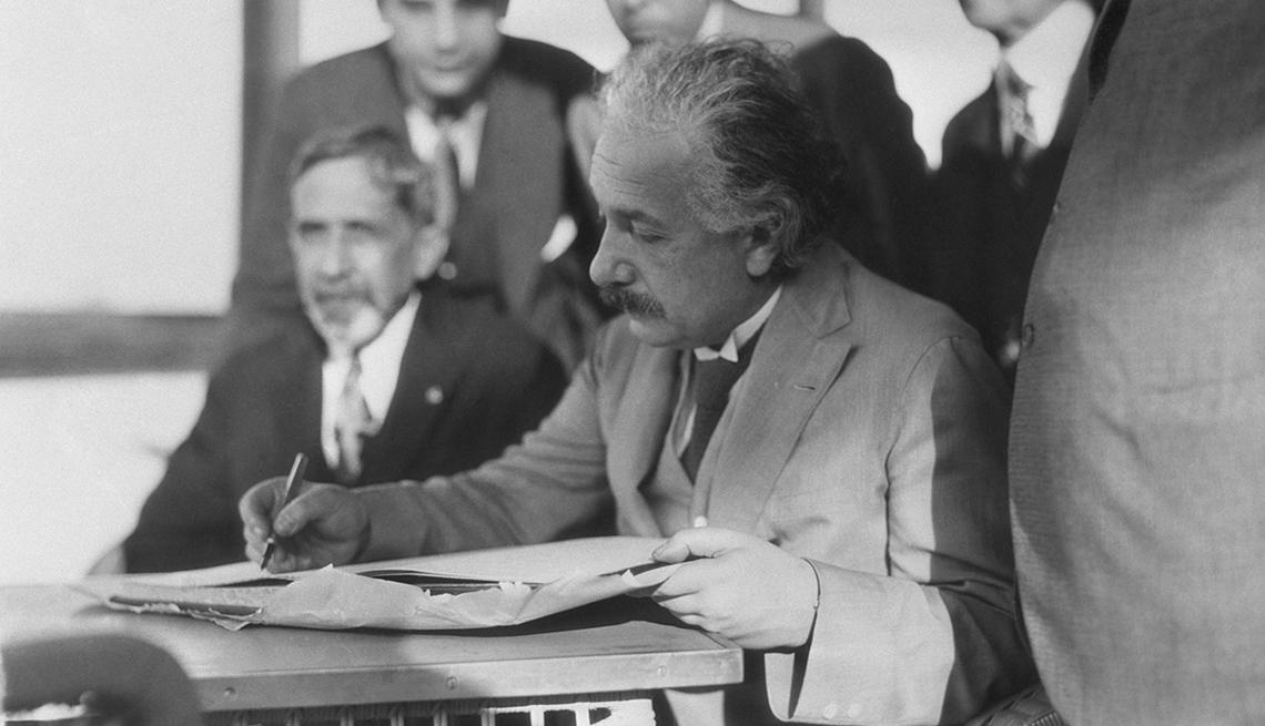 Albert Einstein signing his autograph, Dec. 22, 1930