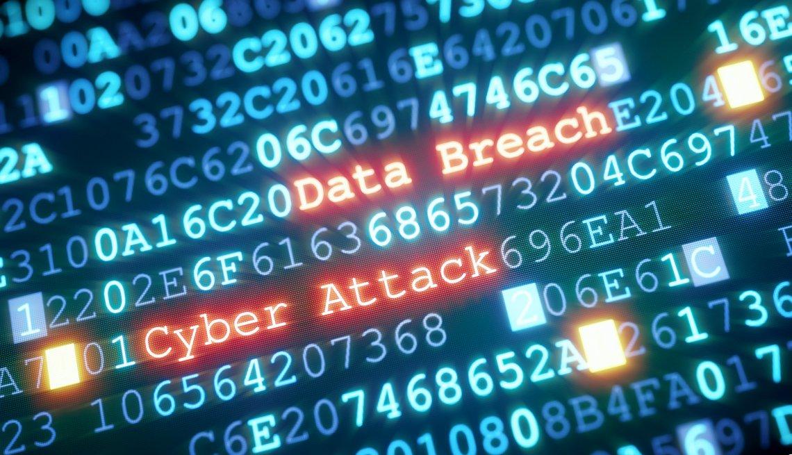 Pantalla de computadora con letras y mostrando el letrero Data Breach y Ciber Attack