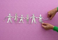 cutting out a string of paper people