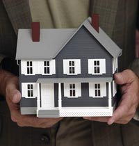 A man holding model house