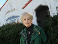 In this Nov. 1, 2010 photograph, Robin Miles, 70, stands outside her Baltimore home. About a year ago, Miles got a reverse mortgage on the three-bedroom Spanish-style house.