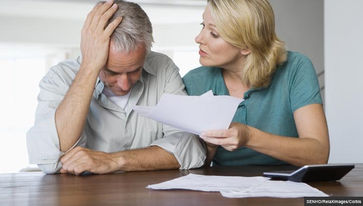 Mature couple arguing about financial situation