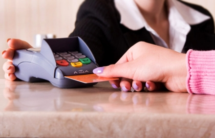 Close-up of woman hand holding credit card, Mistaken credit card charges