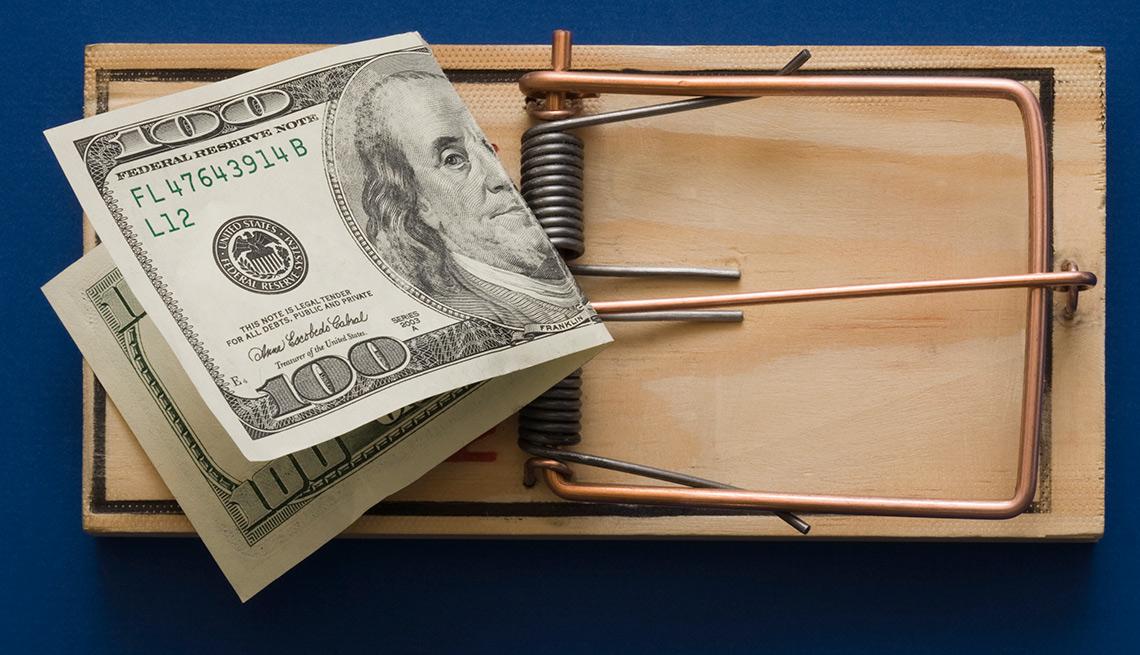 Trampa para ratón con un billete de 100 dólares - Errores en las compras navideñas con tarjetas de crédito