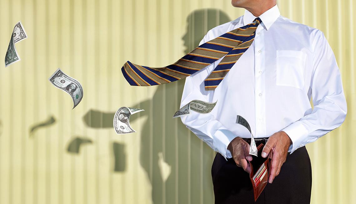 Hombre en corbata con una billetera en la mano y billetes volando