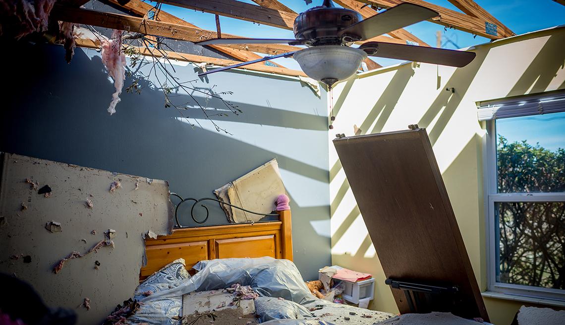 A damaged bedroom in Parker, Fla., in October 2018 after Hurricane Michael.