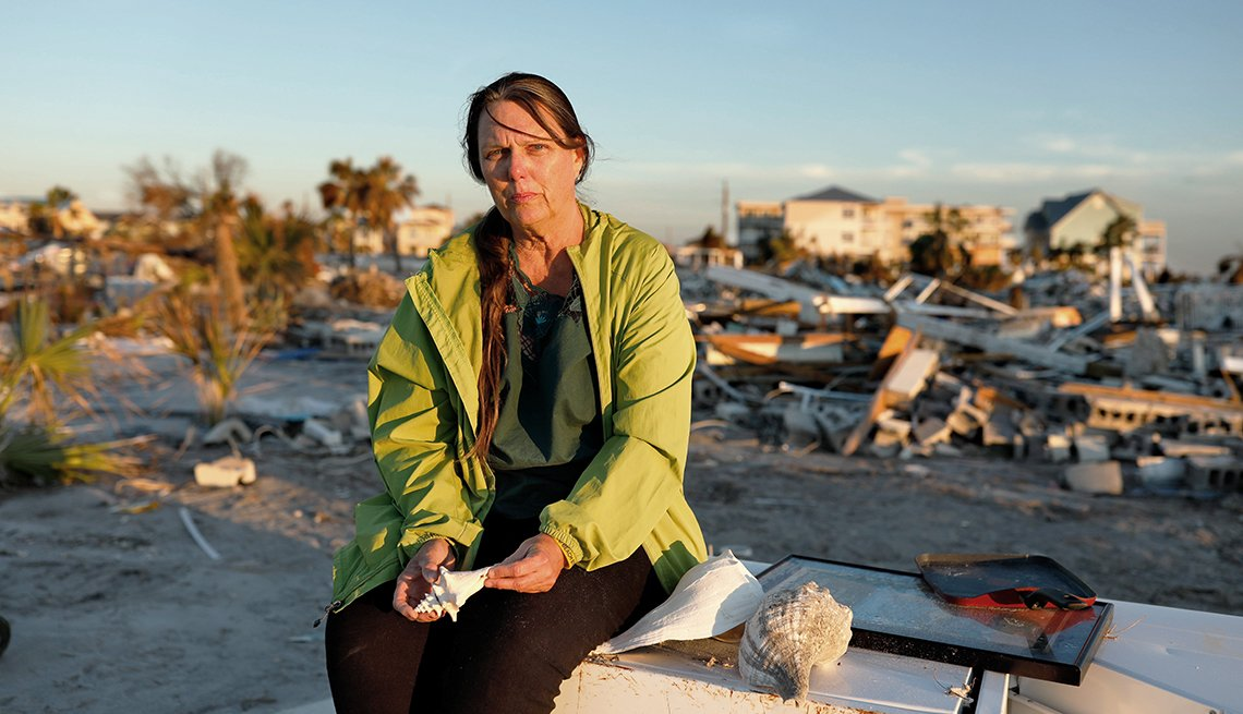 Secrest holds shells found where her home stood before Hurricane Michael.