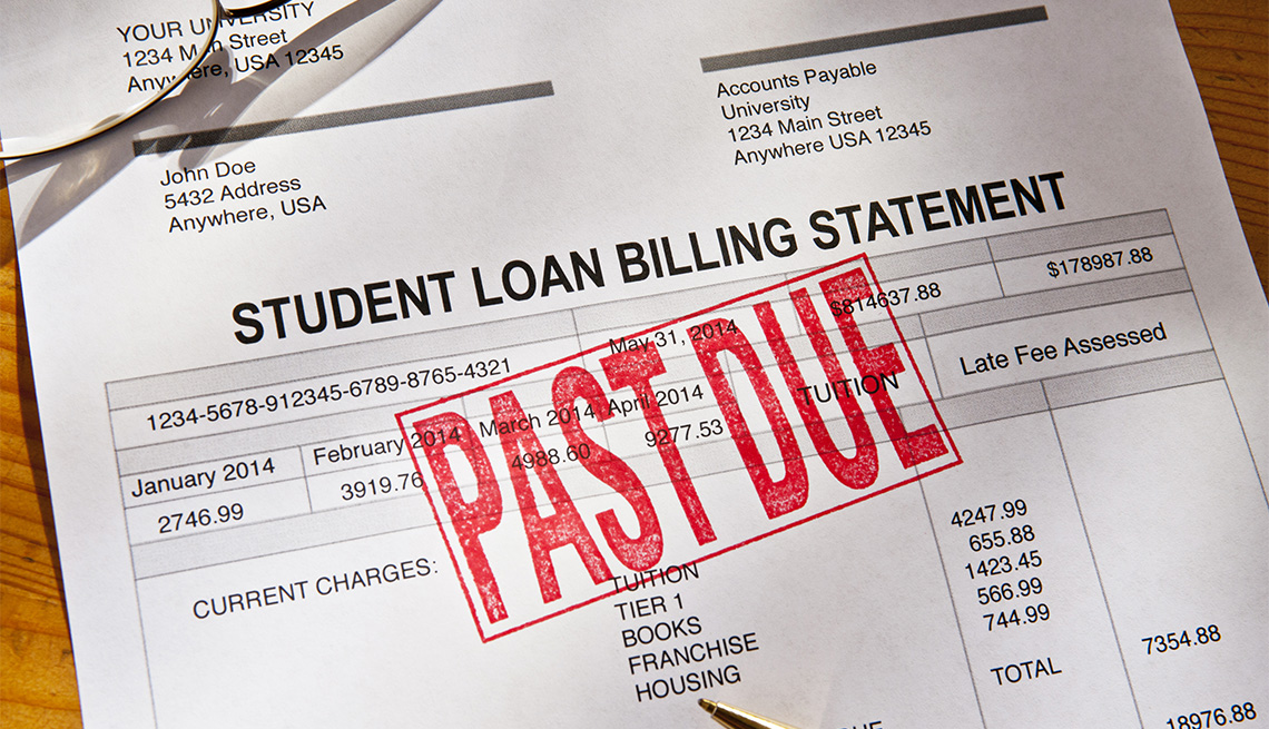 Statement for a past due student loan on a desktop.