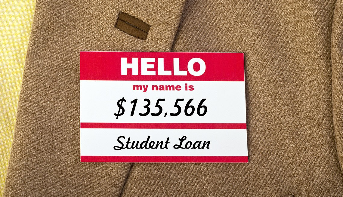 "close up photo of a name badge on a jacket that says ""Hello my name is $135,566 Student Loan"""