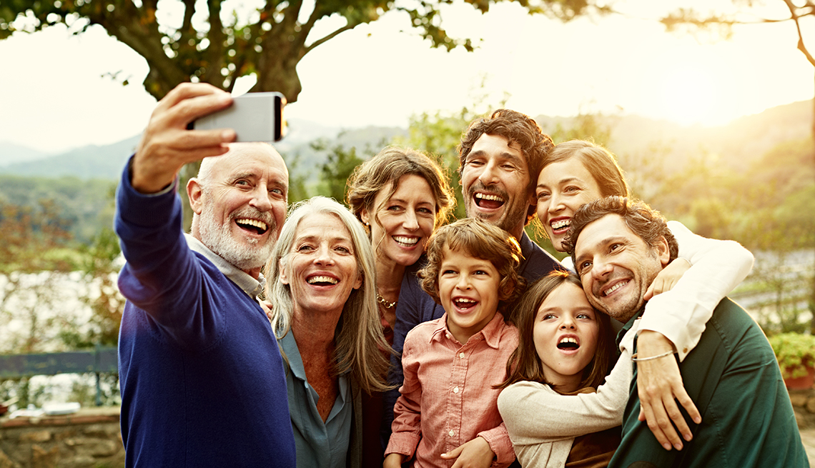 Large blended family taking a photo together