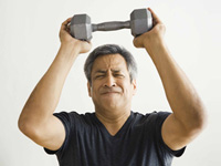 Mature man lifting weight - employees may pay about 11 percent more next year for health insurance premiums.