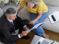Couple reviews finances, Federal rules allow sponsors to hire advisers to help 401K participants