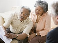 Couple with financial advisor-How to get the best financial advice AARP