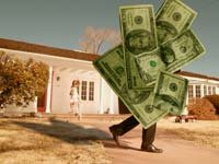 AARP 10 Money Facts- a man covered in dollar bills