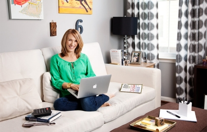 Bev Hollis sits on the couch with a computer in her lap, DIY investing