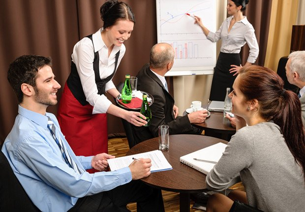 Waitress serving business people conference room, Bad Money Moves