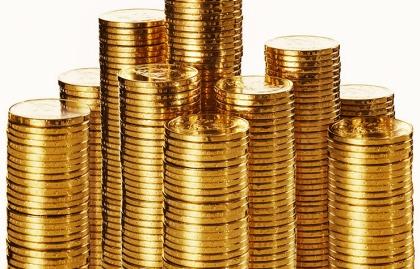 Monedas de oro apiladas - ¿Es buena idea comprar oro?