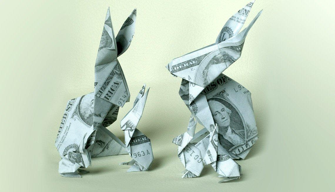 Figuras de conejos hechas con dólares - Inversiones en acciones DRIPs