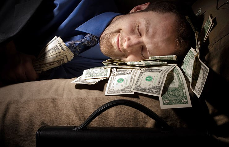 7 Deadliest Financial Sins, man sleeping with money