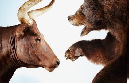 Imagen de un toro frente a un oso - Cosas que debes saber de los mercados de valores para el 2016