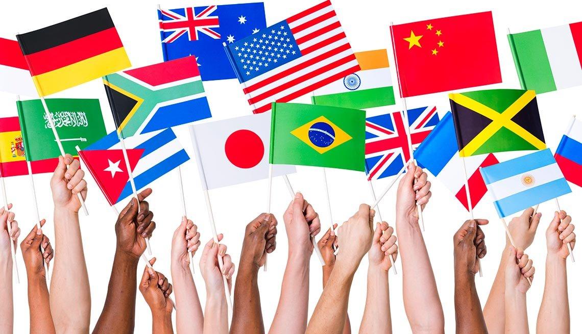 hands holding international flags - investing international