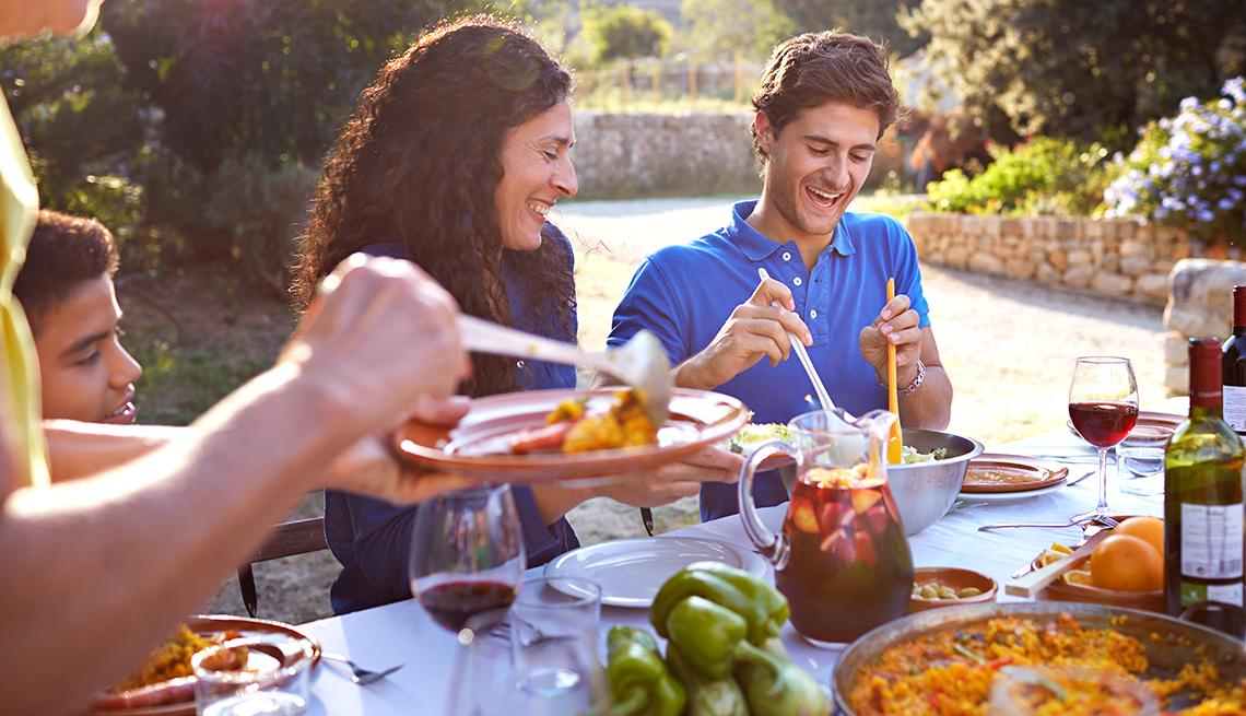 Family celebrating at dinner, Is Money a Good Motivator?
