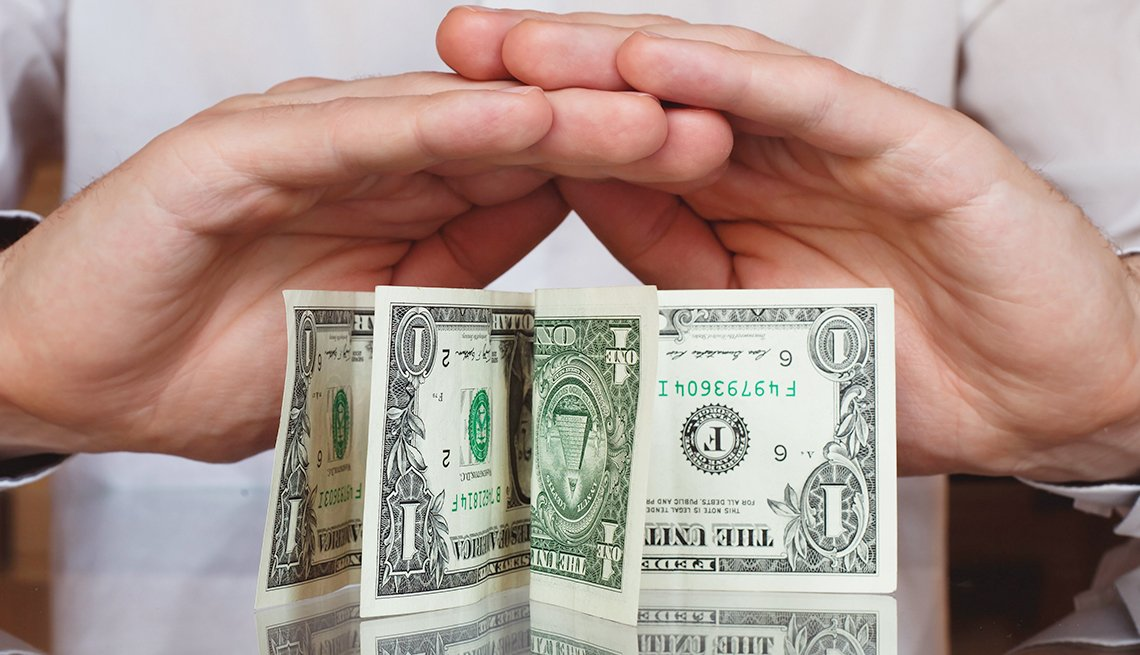 Hands cover and protect money