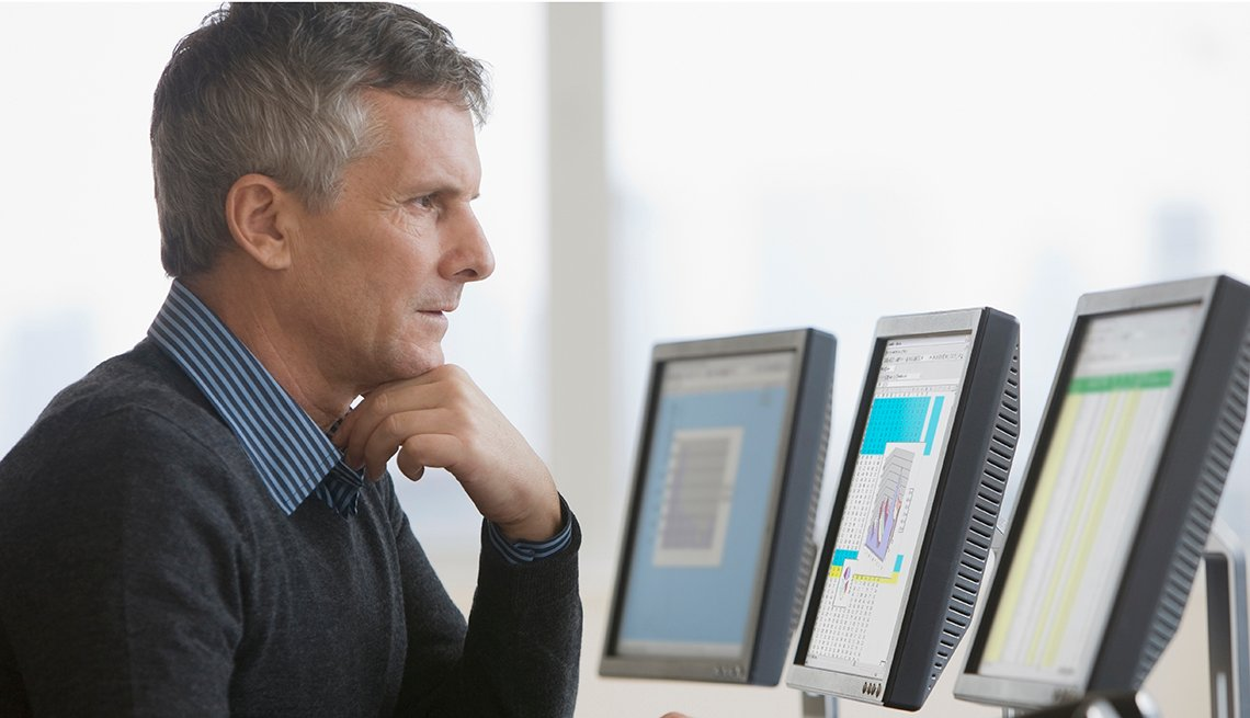 mature man looking concerned at computer screen
