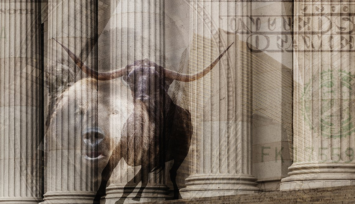 Montage sepia image of a bull, one hundred dollar bill and pillars of ornate building
