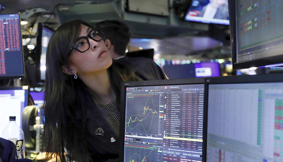 Specialist Erica Fredrickson with worried look as she watches prices fall, on the floor of the New York Stock Exchange, Monday, March 9, 2020.