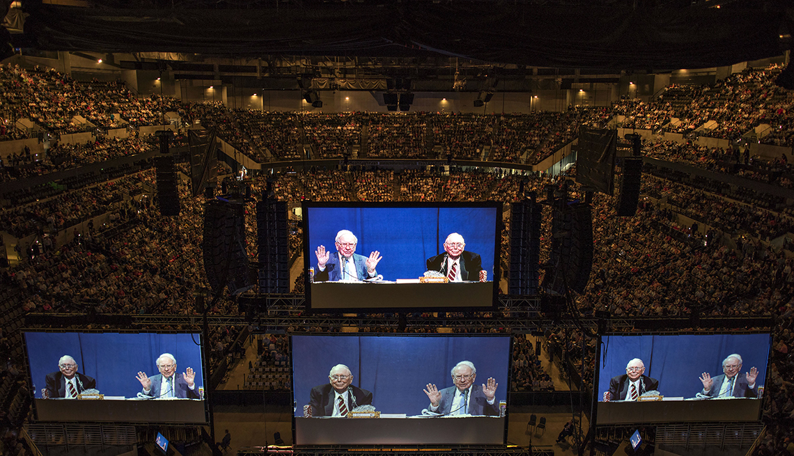 item 8 of Gallery image - monitor screens show Warren Buffett, Berkshire Hathaway Inc. chairman and chief executive officer, and Charles Munger, vice chairman of Berkshire Hathaway Inc., at an annual shareholders meeting