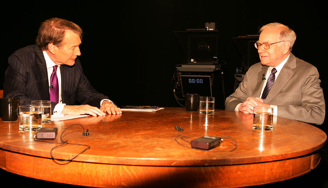 item 6 of Gallery image - Warren Buffett sits in a television studio being interviewed by Charlie Rose in 2006