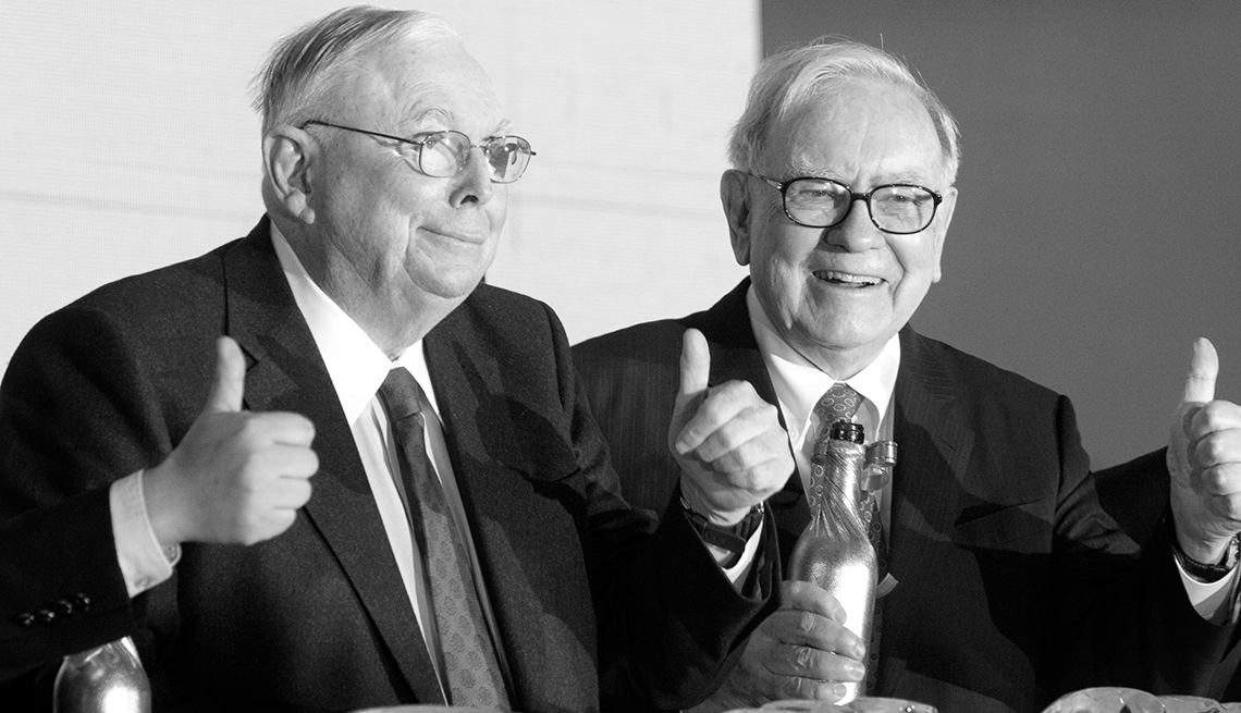 item 3 of Gallery image - Charles Munger, vice chairman of Berkshire Hathaway Inc., left, anSeated at a press event Warren Buffett, chairman of Berkshire Hathaway Inc. give the thumbs up for photo op