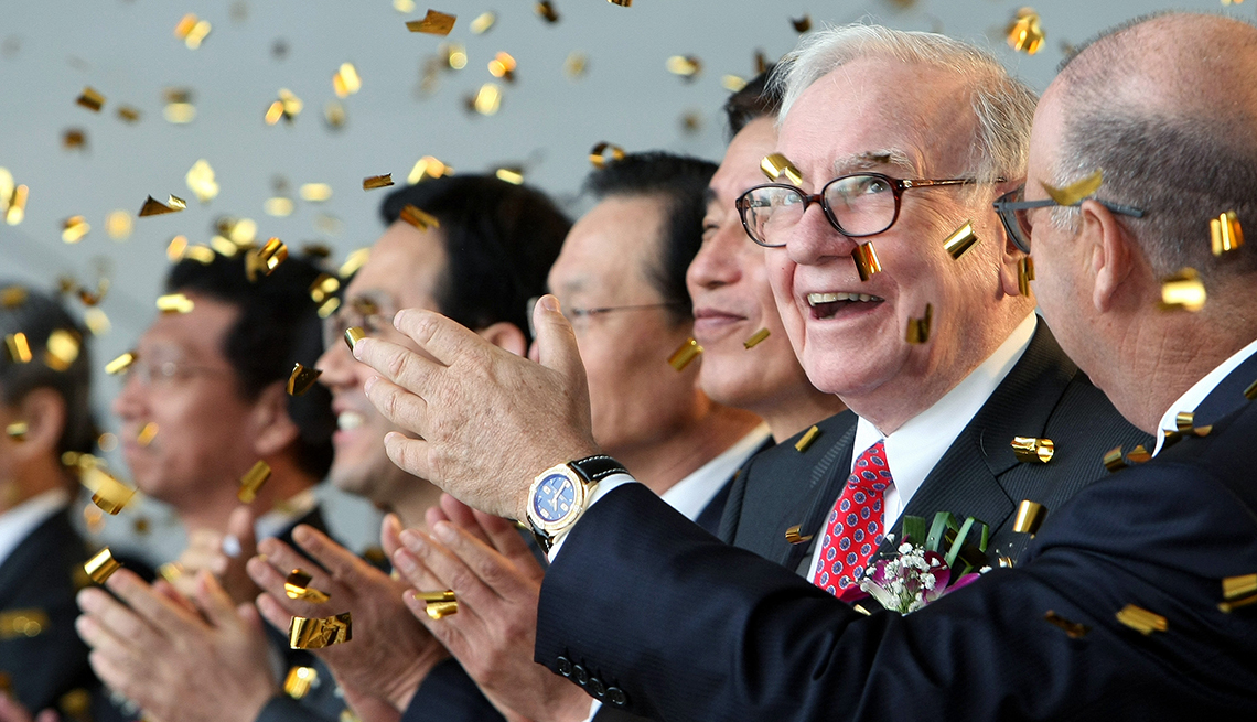 item 10 of Gallery image - gold confetti falls at a groundbreaking ceremony attended by Warren Buffett