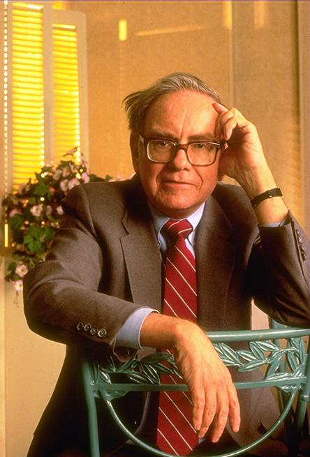 seated portrait from the 1980s of a Berkshire Hathaway chairman Warren Buffett