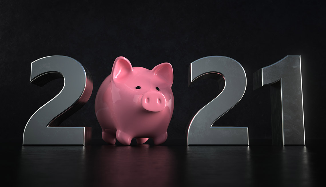 Una alcancía rosa reemplaza el cero en una pantalla que representa el año nuevo 2021.