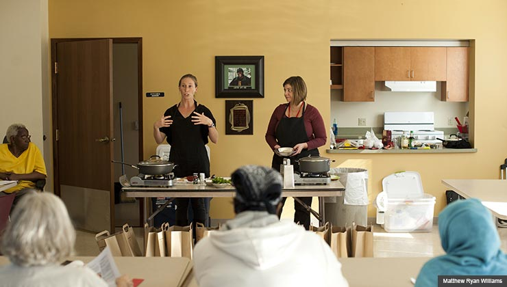 Meghan Lyle, left, and Jennifer Hinson demonstrate recipes during a class for low-income people 50 and older. The 'Pots and Plans' class focuses on small, nutritious and affordable meals.